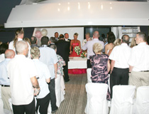 Evening wedding ceremony at sea