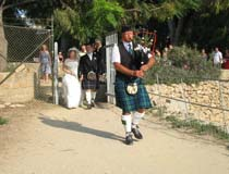 Piper accompanying bride and groom, Cyprus