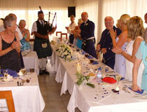 Scottish piper at a wedding reception, Cyprus
