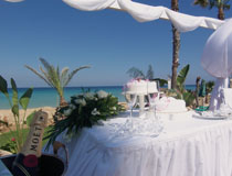 Wedding cake and champagne at Sunrise Beach Hotel