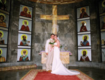Mr & Mrs Anderson posing inside the pretty chapel area located in Rhodes Town Hall