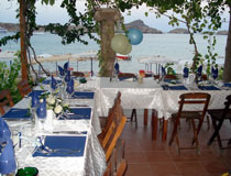 Your wedding reception can take place at the DOlphon Taverna located right by the beachside