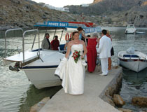Bride arriving by boat, St Paul's Bay, Rhodes