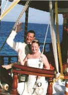 Mr & Mrs Newcombe enjoying a boat trip after their wedding